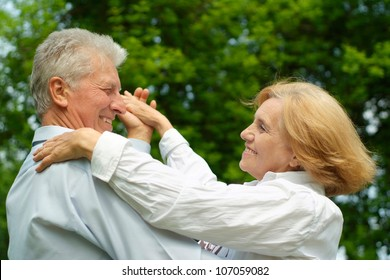 Mature couple enjoy union with nature, fresh air and stunning views