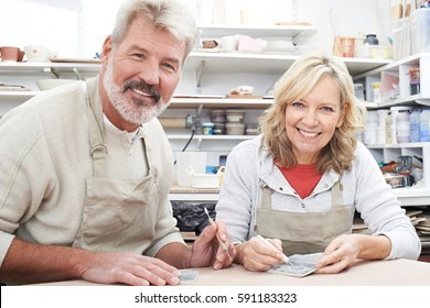 Mature Couple Enjoying Pottery Class Together