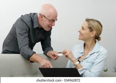 mature couple e-shopping on internet at home