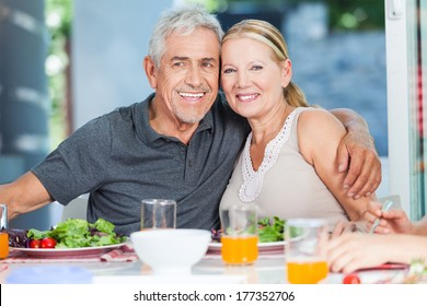 mature couple family lunch home, eating happy love smile, sitting at dinner table