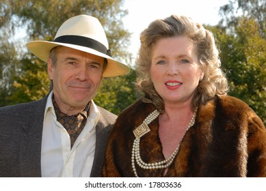 mature couple in  fifties vintage costume at Goodwood Revival event, UK