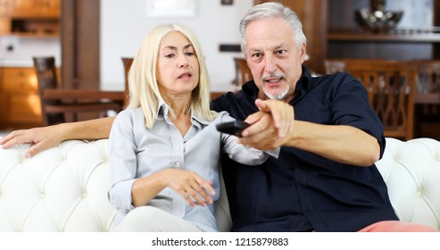 Mature couple having arguments while watching tv