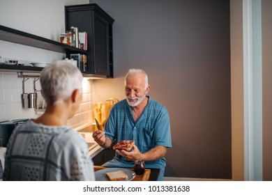 Mature couple having breakfast in the morning