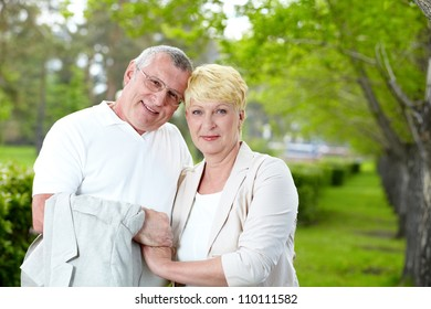 Mature couple having rest on summer
