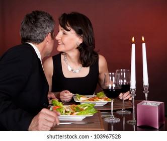 Mature couple having romantic dinner in restaurant