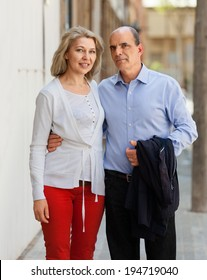 MAture couple hugging while walking around the city