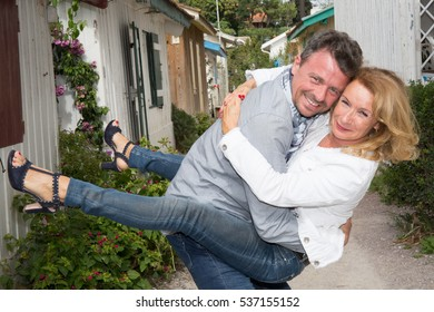 mature couple in love in tourism village near the beach during vacation