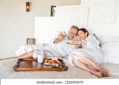 Mature couple in a luxurious hotel room