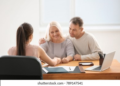 Mature couple at notary public office