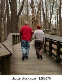 A mature couple on a walk.