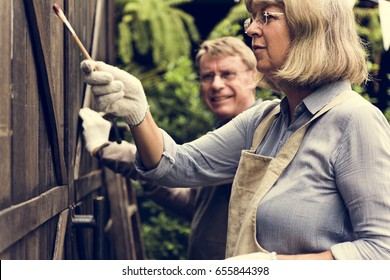 Mature Couple Painting Decorating Together