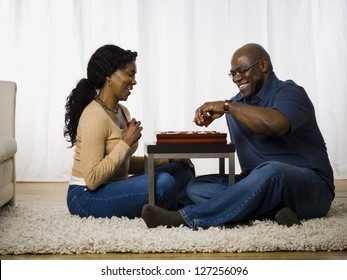 Mature couple playing a board game