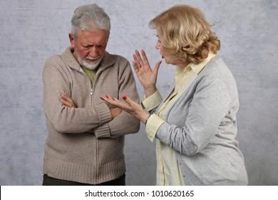 Mature Couple In Quarrel. Senior Woman accuses her husband. Family arguing, disagreement concept