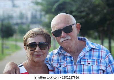 Mature couple resting in park on summer day