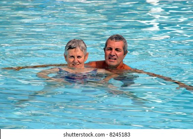 mature couple in the swimming pool