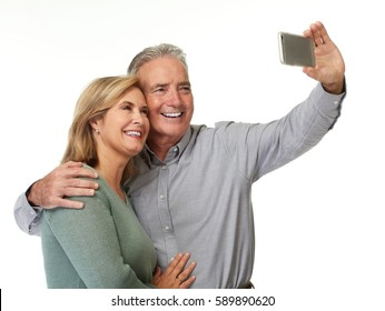Mature couple taking selfie.