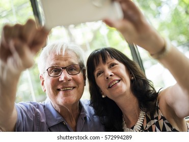 Mature couple taking selfie together