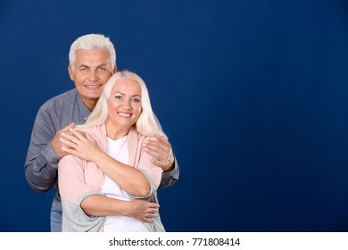 Mature couple together against color background