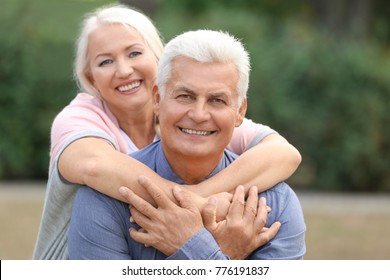 Mature couple together in park