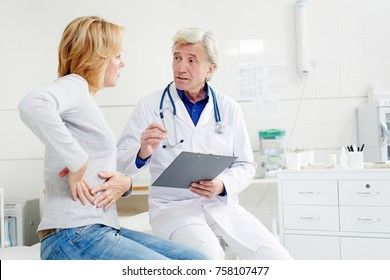 Mature doctor giving recommendations to his patient with pain in right flank