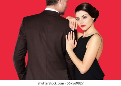 Mature elegant couple posing on color background