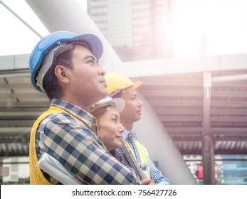 Mature engineer people in hard hats look at the workspace for success.