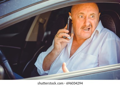 Mature European or American man in white shirt driven dirty car, have a problem on a road. Scary trip and conflict talking to telephone. Accident and trouble situation