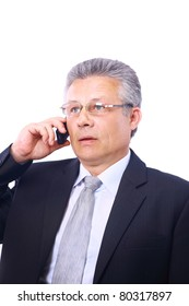 Mature executive man giving explanations and talking at phone mobile