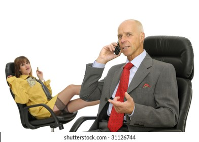 Mature executive with phone and sexy businesswoman in the background