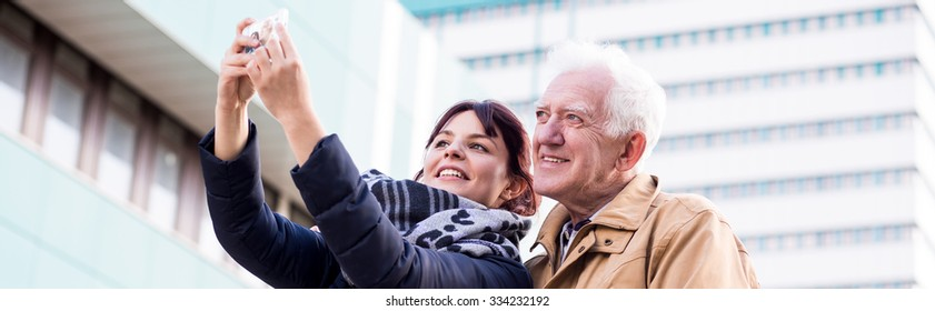 Mature father and daughter are taking selfie