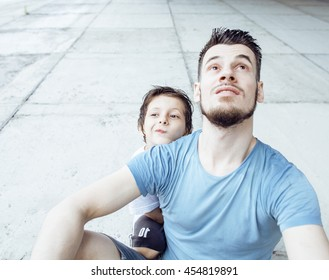mature father with his son under the bridge having fun together happy family, lifestyle people concept