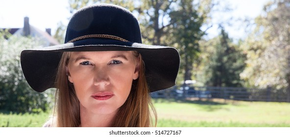 Mature Female Closeup in Black Hat