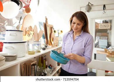 Mature Female Customer Looking At Dish In Cook Shop