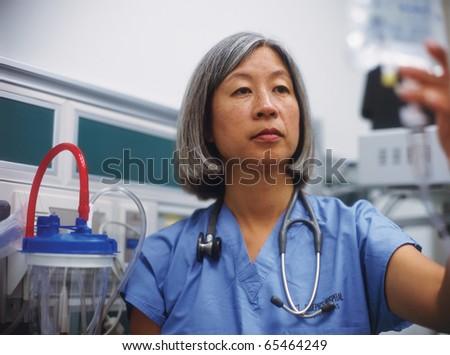 Mature female doctor in hospital room