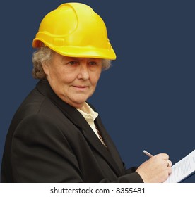Mature female executive taking stock of a project