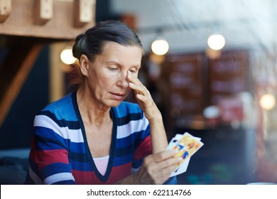 Mature female reminiscing her relatives and crying