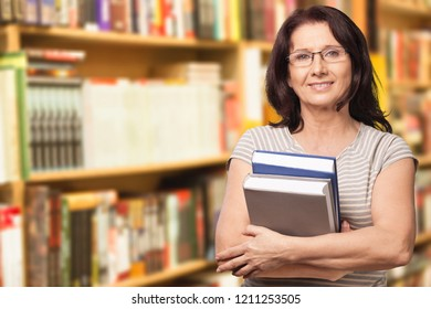 Mature female student with books smiling