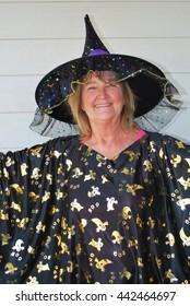 Mature female wearing a halloween costume outside.