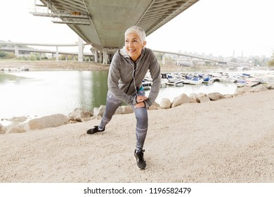 Mature Fit Woman In Sportswear Doing Fitness Exercise , Workout Outdoor.