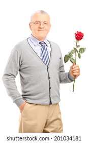Mature gentleman holding a red rose isolated on white background