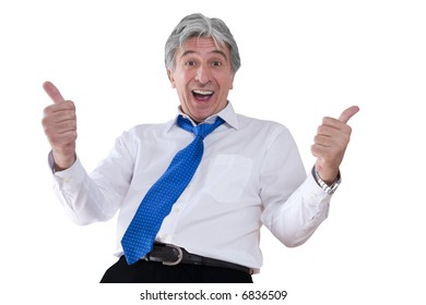 Mature gray-haired smiling businessman with thumbs up.