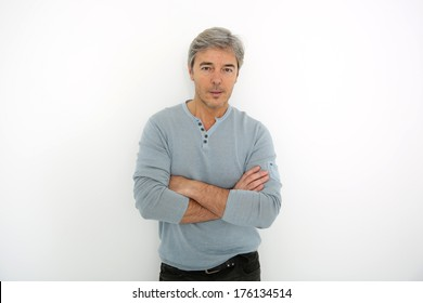 Mature handsome man standing on white background