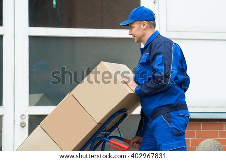 c1b67cbfd861 Mature Happy Delivery Man Carrying Boxes Stock Photo (Edit Now ...