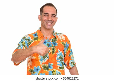 Mature happy Persian man ready for vacation giving thumb up and smiling