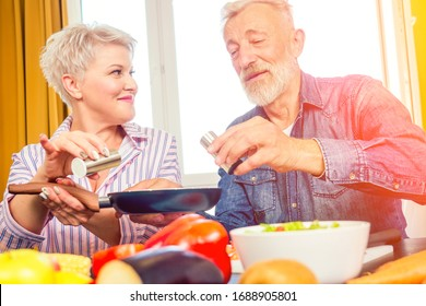 mature healthy woman and retired man cooking smoothie breakfast at home .immunity prevention from corona virus