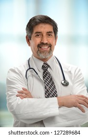 Mature Hispanic Doctor with arms crossed and smiling