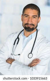 Mature hispanic doctor working in a hospital