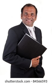 Mature indian business man with folder smiling