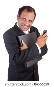 Mature indian business man with phone and folder