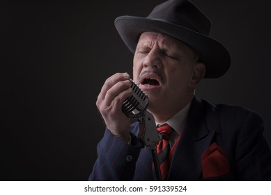 Mature Jazz man singing into a microphone